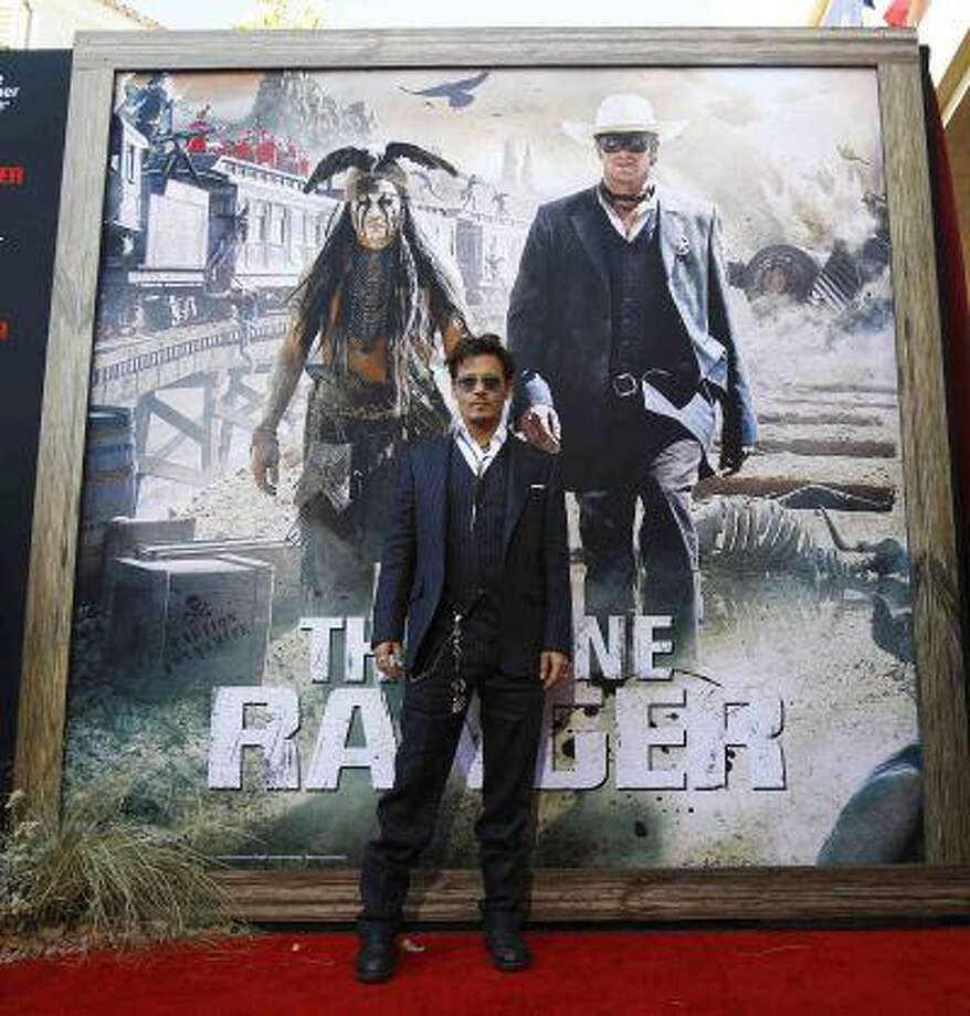"""Cast member Johnny Depp poses at the world premiere of """"The Lone Ranger"""" at Disney California Adventure Park in Anaheim, Calif. The movie opens in the U.S. on July 3. REUTERS/Mario Anzuoni Photo: REUTERS / X90045"""
