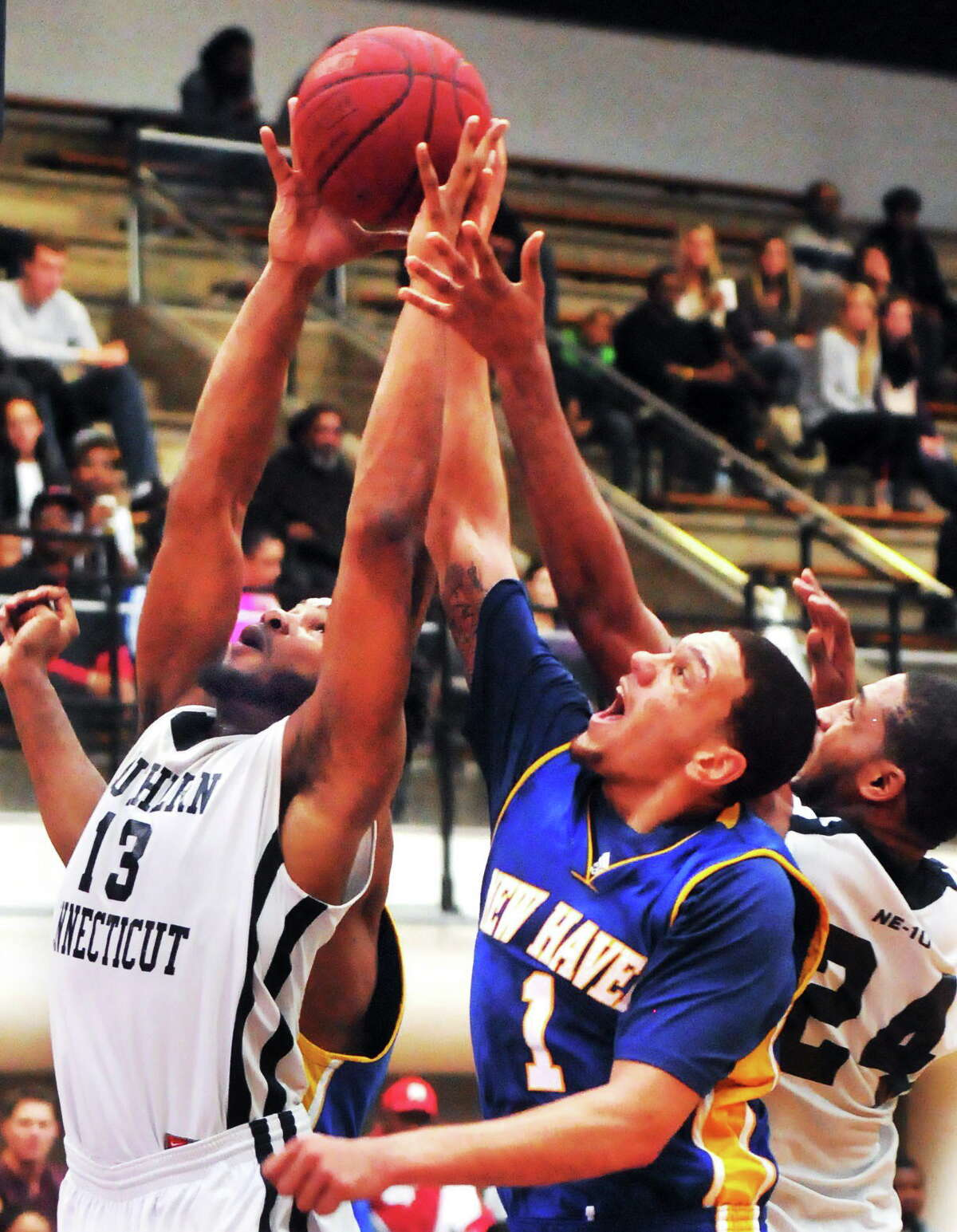 Mara Lavitt — Register SCSU's Greg Langston (13) fights for a rebound with New Haven's Jonny Ocasio during Sunday's game.