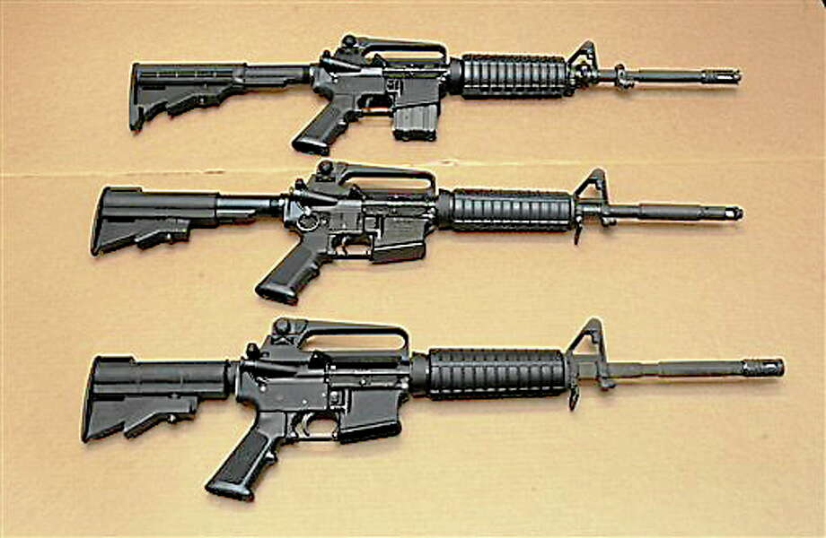 In this file photo, three variations of the AR-15 assault rifle are displayed at the California Department of Justice in Sacramento, Calif.   In the wake of the school shootings at the Sandy Hook Elementary School in Newton Connecticut, California State Sen. President Pro Tem Darrell Steinberg said Wednesday, Jan. 16, 2013, that he expects the Democratic-controlled Legislature to strengthen gun control this year.(AP Photo/Rich Pedroncelli,file) Photo: AP / AP