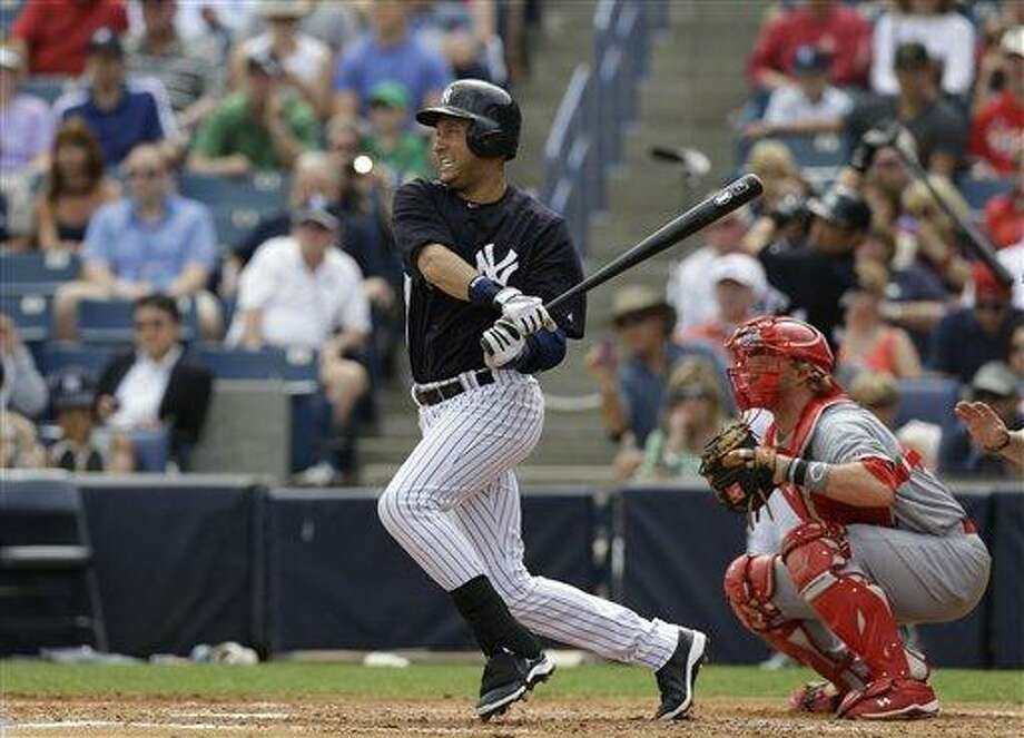 New York Yankees Derek Jeter bats in a spring training baseball game against the St. Louis Cardinals in Tampa, Fla., Monday, March 11, 2013.  (AP Photo/Kathy Willens) Photo: ASSOCIATED PRESS / AP2013