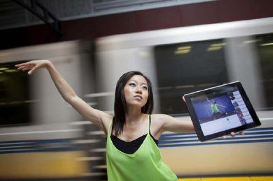 "Karen X. Cheng poses for a portrait at the South San Francisco BART station where she filmed her viral YouTube video ""Girl Learns to Dance in a Year,"" in San Francisco, Calif., on Thursday, July 25, 2013."