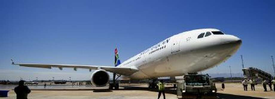 An airplane arrives at its parking bay in Cape Town on February 8, 2011