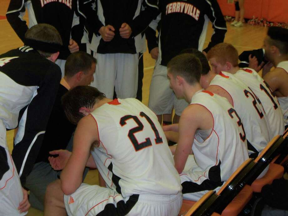 The Terryville Kangaroos regroup during a timeout. Old Lyme defeated Terryville 66-60. Photo by Peter Wallace/Register Citizen