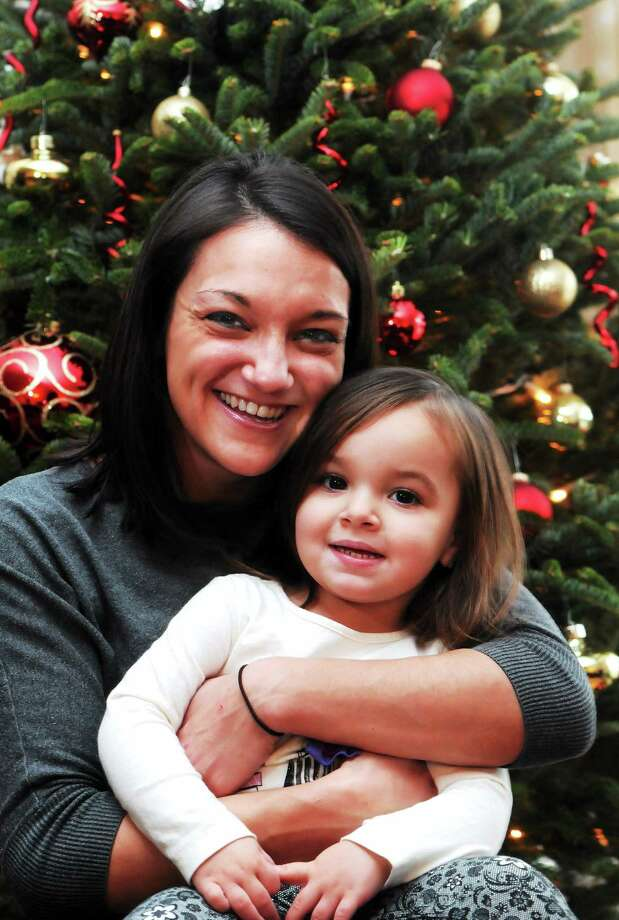 (Mara Lavitt ó New Haven Register)   December 22, 2013 East Haven  Amanda Calandro at home in East Haven with her daughter Meadow Stout, age 2. Calandro was given a $500 tip while waitressing in Hamden by a man honoring his brother's will. The tip made it possible for Calandro to buy gifts for Meadow. Photo: Journal Register Co. / Mara Lavitt