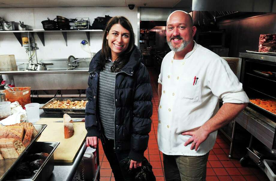 Danyel Aversenti, left, site director for Community Plates, and Chef Frank Proto of Barcelona Wine Bar & Restaurant in the kitchen of the New Haven eatery. Photo: Arnold Gold — New Haven Register