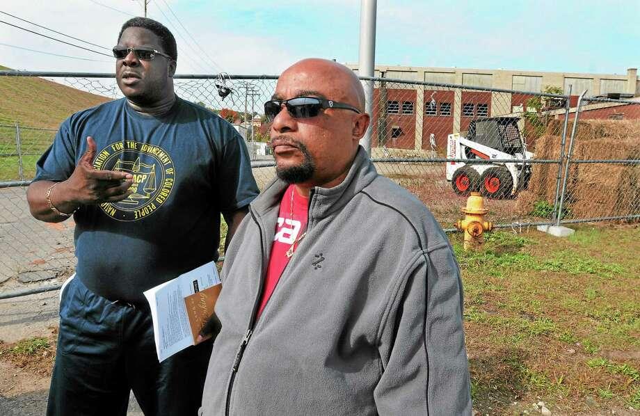 Greg Johnson, left, president of the NAACP Naugatuck Valley chapter, stands outside the Ansonia Department of Public Works with maintenance worker Tim Holman. Photo: Mara Lavitt — New Haven Register      / Mara Lavitt