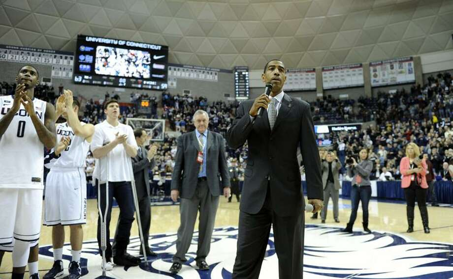 Connecticut coach Kevin Ollie speaks with fans after his team's 63-59 overtime win against Providence in an NCAA college basketball game in Storrs, Conn., Saturday, March 9, 2013. (AP Photo/Fred Beckham) Photo: AP / AP2013