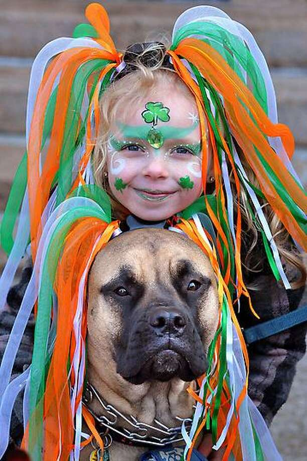 "New Haven--  Grace Wilson, 7, waits for the parade with her Bull Mastiff, ""Macie"" along Church Street. They are from New Haven.  Photo-Peter Casolino"