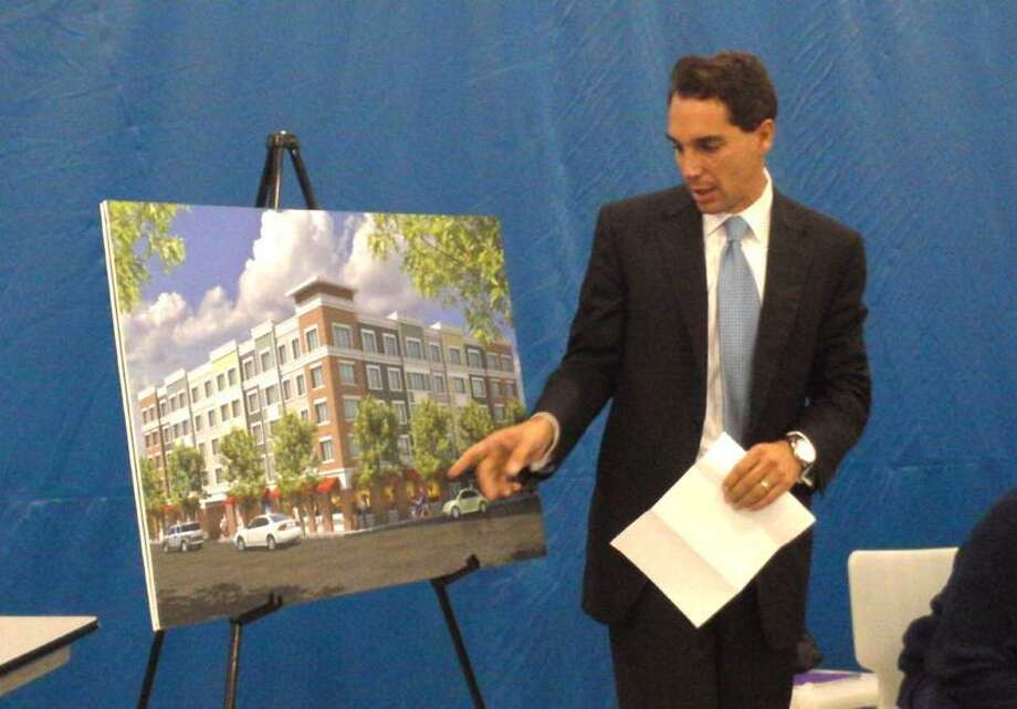 Randy Salvatore points to revised elements of his Chapel West apartment proposal at the October meeting of the Dwight Central Management Team. Joe Amarante/Register