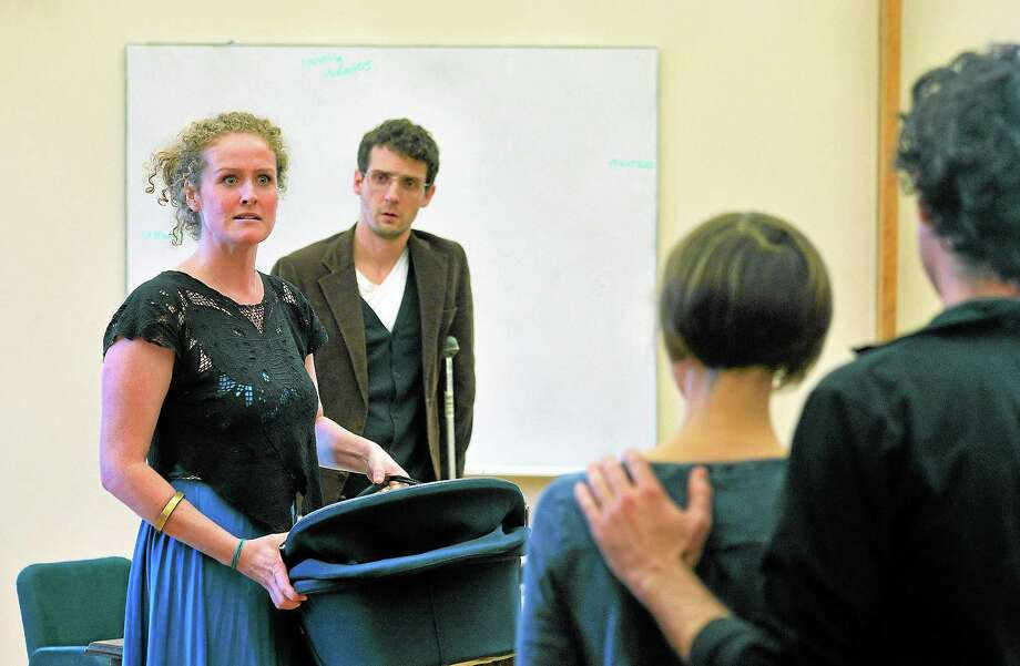 "Brenda Meaney as Marion in Caryl Churchill's ""Owners."" With her in a rehearsal run-through is Jobe Earle, left, Sarah Manton and Tommy Schrieder. Photo: Peter Casolino — New Haven Register"