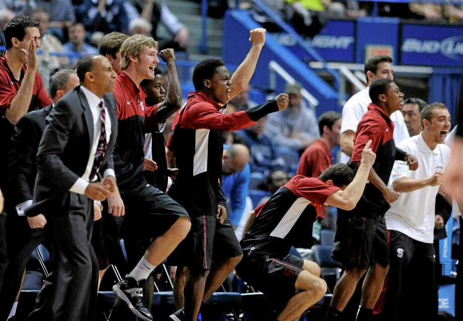Stanford players celebrate their 53-51 victory over UConn on Wednesday night at the XL Center in Hartford. Photo: Fred Beckham — The Associated Press   / FR153656 AP