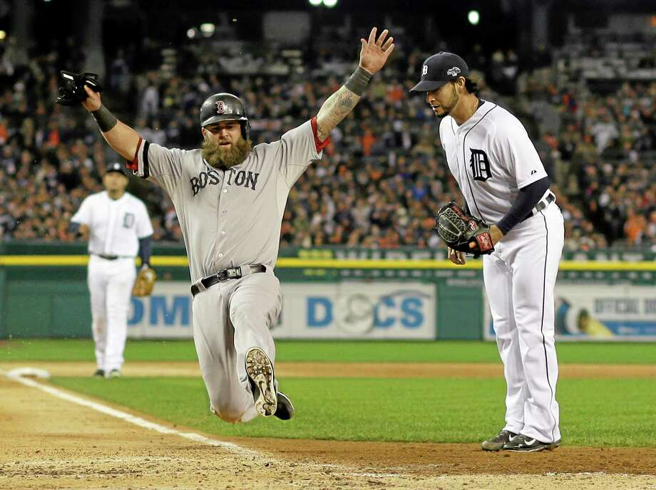 Boston's Mike Napoli scores on a wild pitch by the Tigers' Anibal Sanchez in the third inning during Game 5 of the ALCS on Thursday. Photo: Matt Slocum — The Associated Press   / AP