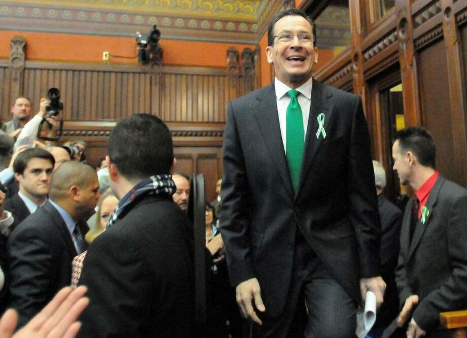 """Connecticut Gov. Dannel P. Malloy enters the Hall of the House Wednesday to give the 2012 State of the State Address at the State Capitol in Hartford. In his speech, Malloy said, """"When it comes to preventing future acts of violence in our schools, let me say this: more guns are not the answer."""" Peter Hvizdak/New Haven Register Photo: New Haven Register / ©Peter Hvizdak /  New Haven Register"""