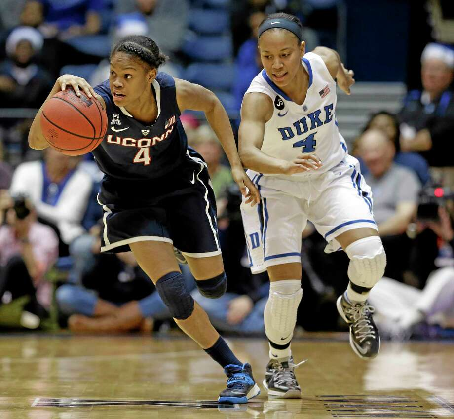 Duke's Chloe Wells chases UConn's Moriah Jefferson, left, during the Huskies' win on Tuesday in Durham, N.C. Photo: Gerry Broome — The Associated Press   / AP