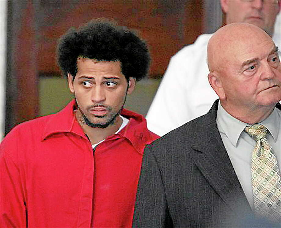 In this June 28 file photo, Carlos Ortiz, an associate of ex-New England Patriot Aaron Hernandez, enters the Attleboro District Court with attorney John Connors, right, for his arraignment on weapons charges in Attleboro, Mass. Ortiz was arraigned Friday on an accessory to murder charge related to the case against Hernandez. He pled not guilty. Photo: George Rizer — Boston Globe   / Pool, The Boston Globe