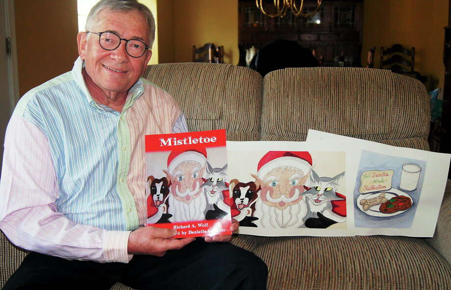 "Retired speech and language pathologist Richard Wolf  first told students in Madison the story of Santa's dog ""Mistletoe"" in the early '90s, and now it's finally out in book form. Photo: Liz Rubin"