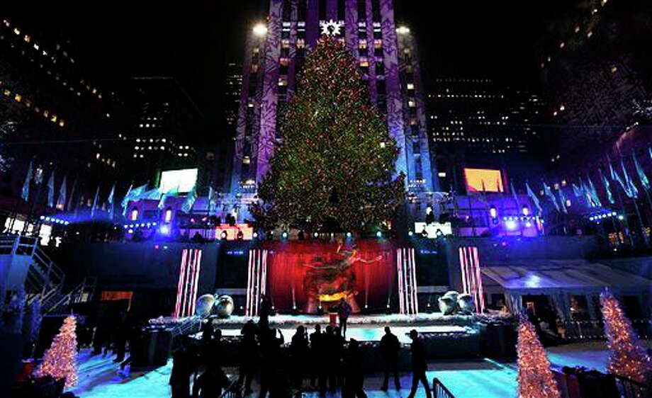 FILE - This Dec. 4, 2013 file photo shows the Rockefeller Center Christmas tree in New York. It's that time of year: holiday music time. And with holiday music comes all the strange and twisted things we sometimes think we're hearing. Mondegreens, the moniker for misheard words in song, aren't restricted to holiday standards, of course, but the old-timey language of some seems to serve as a botched-lyric magnet. (AP Photo/Kathy Willens, File) Photo: AP / AP