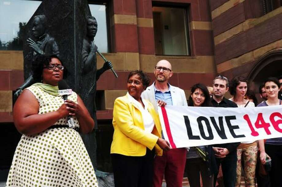 Amistad America's new executive director Hanifa Washington along with members of Love 146 during a ceremony to announce her new post in front of New Haven City Hall July 02, 2013. vmWilliams