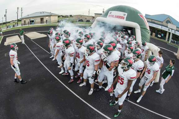 The Woodlands Highlanders take the field during the high school football game between The Woodlands Highlanders and the George Ranch Longhorns at Traylor Stadium in Rosenberg, TX on Friday, September 16, 2016.