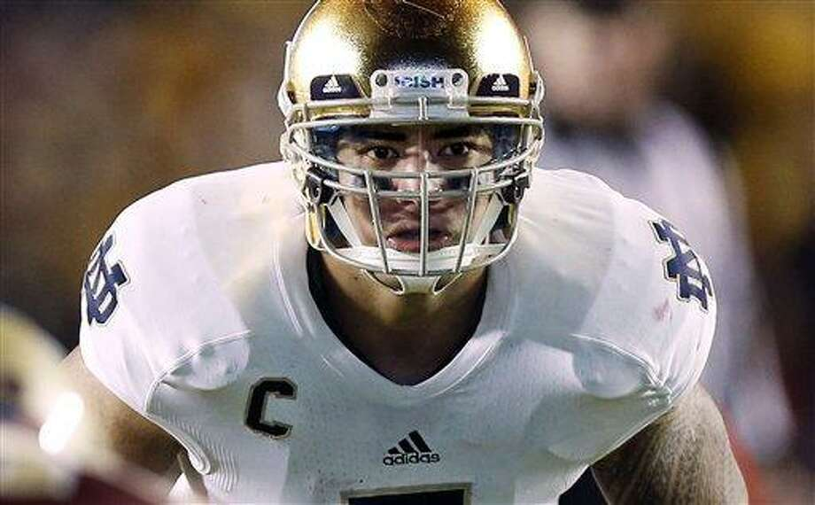 In this Nov. 10, 2012, file photo, Notre Dame linebacker Manti Te'o waits for the snap during the second half of Notre Dame's 21-6 win over Boston College in a NCAA college football game in Boston. Te'o is the Walter Camp Football Foundation Player of the Year. (AP Photo/Winslow Townson, File) Photo: AP / FR170221 AP