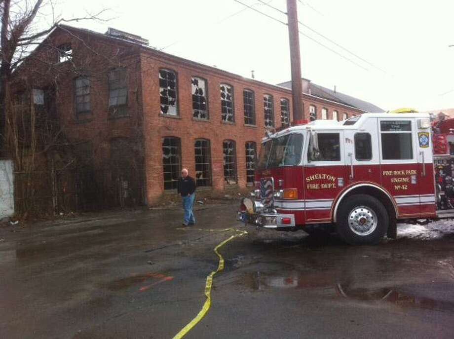 Firefighters put out a blaze at the Apex Tool Co. building early Wednesday on Canal Street in Shelton. The fire also spread to the nearby Better Packaging Co. Peter Hvizdak/Register