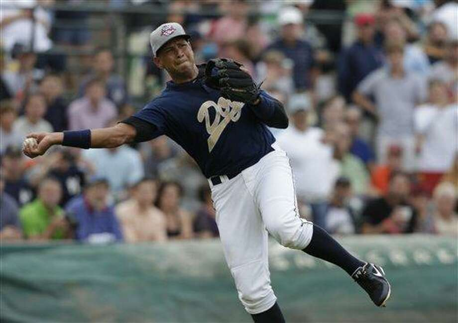 New York Yankees' Alex Rodriguez throws to first during the first inning in his first rehab game with the Charleston RiverDogs in Charleston, S.C., Tuesday, July 2, 2013. (AP Photo/Chuck Burton) Photo: AP / AP