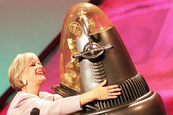 "Actress Anne Francis and Robby the Robot, who were in the 1956 science fiction thriller ""Forbidden Planet,"" share a hug during a TV special in 1998. Robby had artificial intelligence and was benevolent."