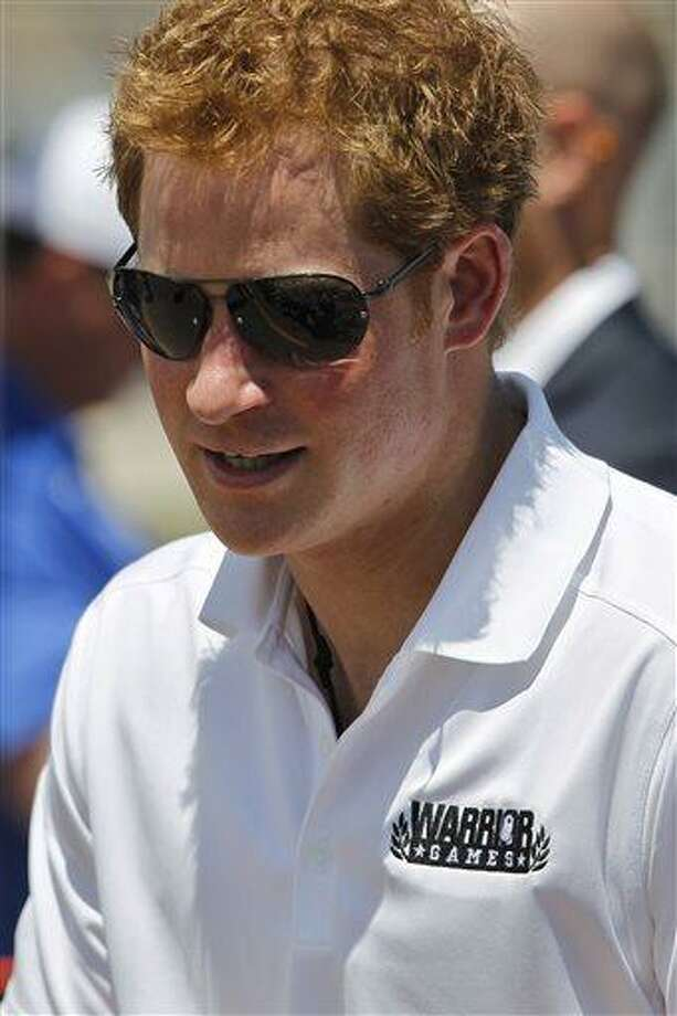 Prince Harry of Britain attends the 2013 Warrior Games, at the U.S. Air Force Academy, in Colorado, Sunday May 12, 2013. The Warrior Games is a competition for wounded, ill and injured service members. (AP Photo/Brennan Linsley) Photo: AP / AP