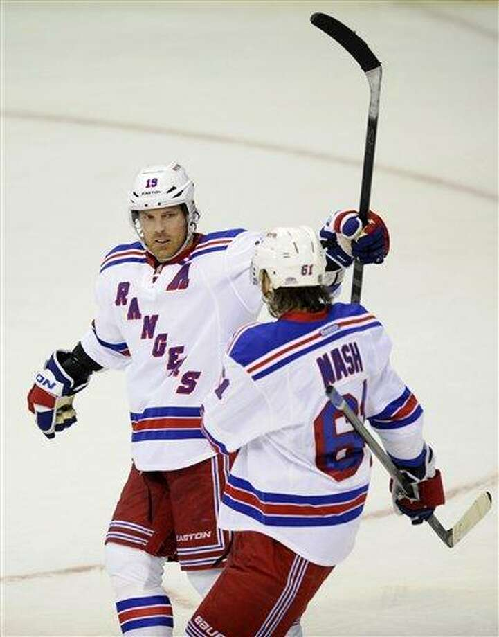 New York Rangers center Brad Richards (19) celebrates his goal with Rick Nash (61) against the Washington Capitals during the third period of an NHL hockey game Sunday March 10, 2013, in Washington. The Rangers won 4-1.(AP Photo/Nick Wass) Photo: ASSOCIATED PRESS / AP2013