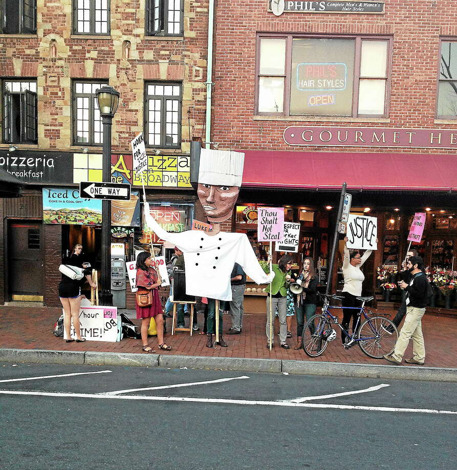 Protesters at Gourmet Heaven Friday over charges of alleged wage theft. Photo: Mary E. O'Leary — New Haven Register