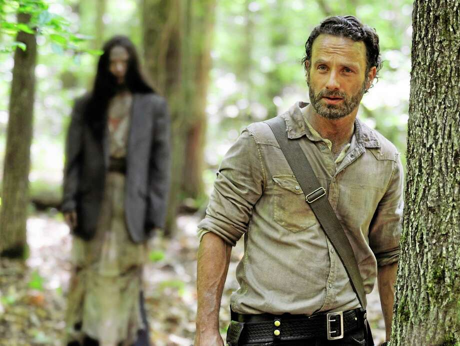 """This image released by AMC shows Andrew Lincoln as Rick Grimes in a scene from the season four premiere of """"The Walking Dead."""" The zombies on """"The Walking Dead"""" are relentless. The AMC series returned for its fourth season on Sunday, Oct. 13, 2013, with its biggest audience ever. Photo: Gene Page—AMC—The Associated Press   / AMC"""