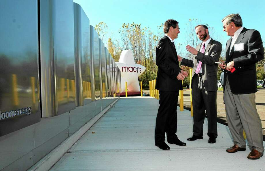 (Mara Lavitt — New Haven Register) October 18, 2013 CheshireBloom Energy and CEFIA completed the installation of a Bloom Energy fuel cell at the Macy's fulfillment center in Cheshire. At the ribbon-cutting event were, from left, Bloom Energy's Matt Ross, CEFIA's David Goldberg, and Macy's Peter Longo. Photo: Journal Register Co. / Mara Lavitt