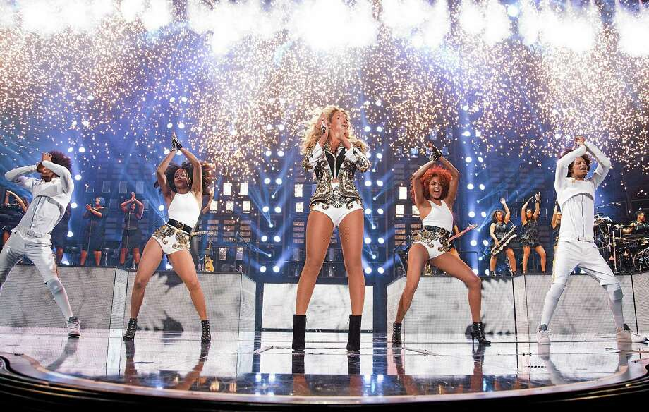 "Beyonce performs onstage at her ""Mrs. Carter Show World Tour 2013"" Friday at the United Center in Chicago, Ill. Photo: Robin Harper — Invision For Parkwood Entertainment   / Invision"