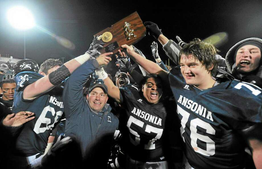 Members of the Ansonia football team celebrate after their 51-12 win over Woodland in the Class S championship game earlier this year. Photo: Mara Lavitt — Register   / Mara Lavitt