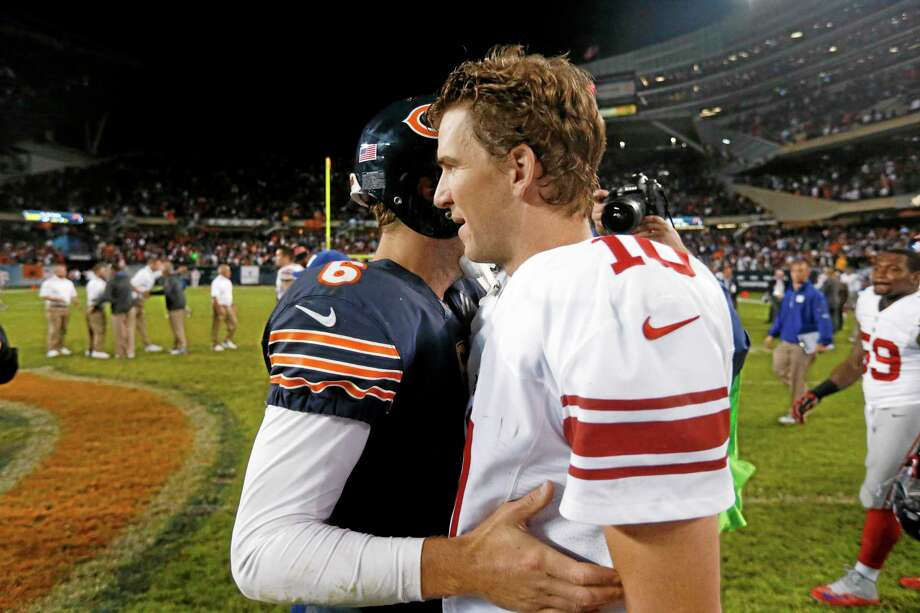 New York Giants quarterback Eli Manning congratulates Bears quarterback Jay Cutler after their Oct. 10 game in Chicago. The Bears won 27-21. Photo: Charles Rex Arbogast — The Associated Press   / AP
