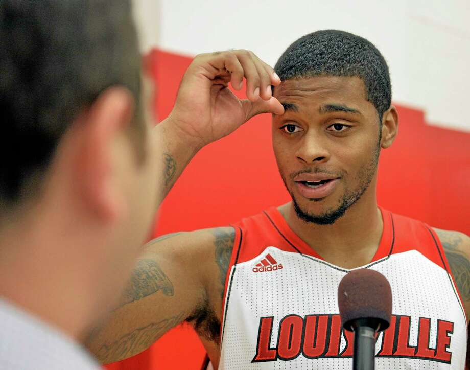 Louisville's Chane Behanan fields questions during media day on Saturday in Louisville, Ky. Photo: Timothy D. Easley — The Associated Press   / FR43398 AP