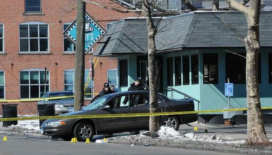 Police Saturday, March 9, 2013 investigate the scene of a brawl at Cody's Diner at 95 Water Street in New Haven, Connecticut. Photo by Peter Hvizdak / New Haven Register Photo: New Haven Register / ©Peter Hvizdak /  New Haven Register