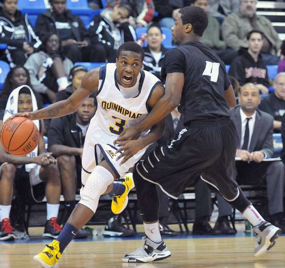 Quinnipiac's Kendrick Ray drives to the hoop during a game played earlier this season. (Peter Casolino/Register)