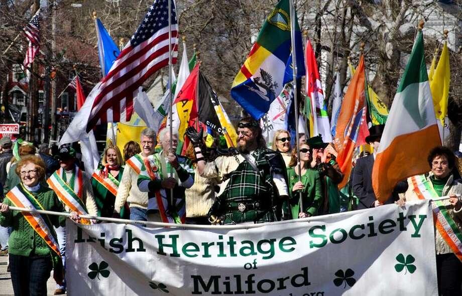 "Milford St. Patrick's Day Parade--The Irish Heritage Society  walks the route.  SocietyMelanie  Stengel/Register   <a href=""mailto:mstengel@nhregister.com"">mstengel@nhregister.com</a>"