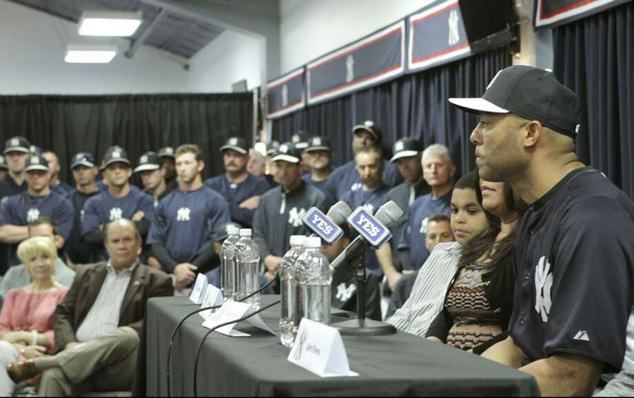 Yankees front office, coaches and teammates listen as New York Yankees pitcher Mariano Rivera, far right, who holds baseball's all-time saves record, announces his plans to retire at the end of the 2013 season during a news conference at Steinbrenner Field Saturday, March 9, 2013 in Tampa, Fla. (AP Photo/Kathy Willens) Photo: AP / AP2013