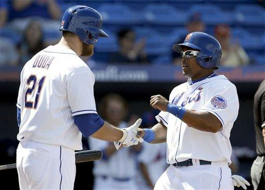 New York Mets' Marlon Byrd, right, is congratulated by teammate Lucas Duda after scoring on an RBI single by Ike Davis during the third inning of an exhibition spring training baseball game Saturday, March 9, 2013, in Port St. Lucie, Fla. (AP Photo/Jeff Roberson) Photo: AP / AP