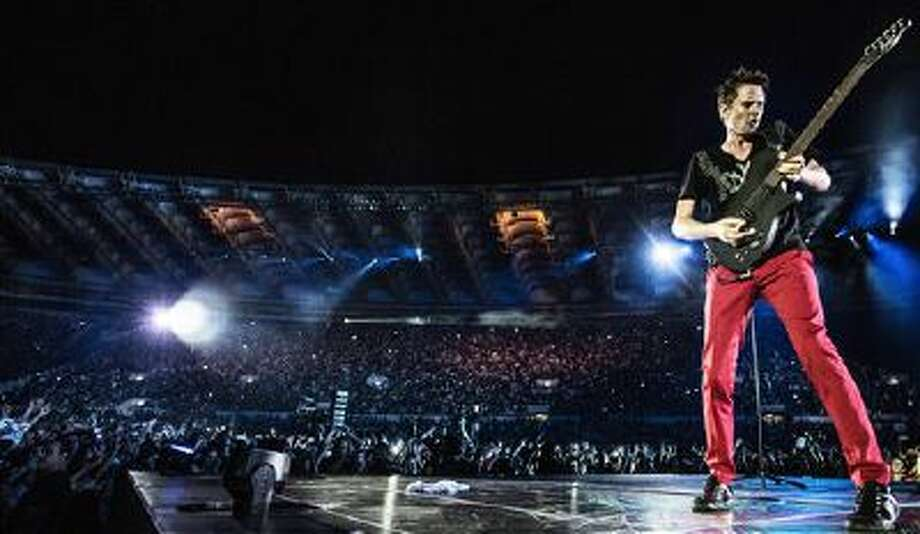 "This photo released by MUSE shows Muse performing in their 4K Ultra High Definition concert film, ""Muse - Live at Rome Olympic Stadium, "" in July 2013. Following advance screenings, the film will be released in over 700 cinemas in 40 countries for limited screenings from Nov. 6, 2013. Photo: AP / MUSE"