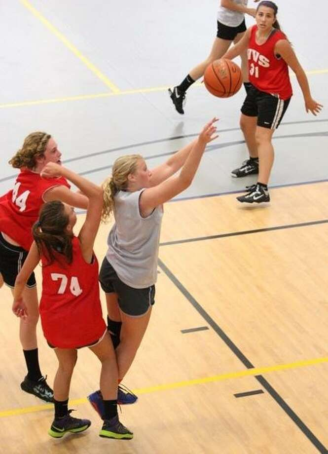 JOHN HAEGER @ONEIDAPHOTO ON TWITTER/ONEIDA DAILY DISPATCH Oneida's Riley Markle puts up a shot for two as VVS' Teresa Pitman (44) and Kaitlyn Reeder (74) defend in the second half of the summer league game  on Tuesday, July 2, 2013 in Utica.