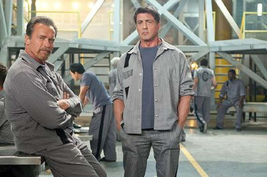 "Arnold Schwarzenegger and Sylvester Stallone seek to survive - and find a way to break out of - a new high-tech prison in ""Escape Plan."" / © 2013 Summit Entertainment, LLC.  All rights reserved."