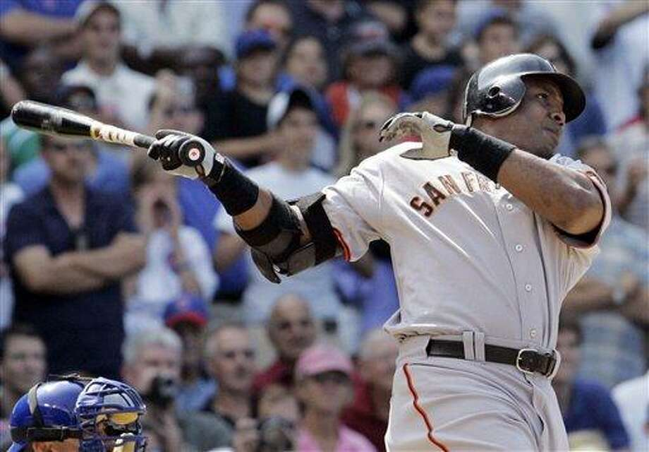 FILE - In this July 19, 2007, file photo, San Francisco Giants' Barry Bonds hits a three-run home run during the seventh inning of a baseball game against the Chicago Cubs in Chicago. With the cloud of steroids shrouding the candidacies of Bonds, Roger Clemens and others, baseball writers on Wednesday, Jan. 9, 2013, might not elect anyone to the Hall of Fame for only the second time in four decades. (AP Photo/M. Spencer Green, File) Photo: AP / AP