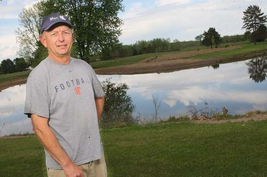 PHOTO BY JOHN HAEGER @ONEIDAPHOTO ON TWITTER/ONEIDA DAILY DISPATCH Dave Neiman stands near a pond at Old Erie Golf Club in Durhamville.