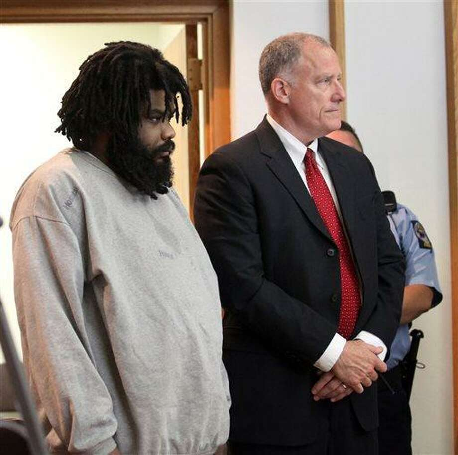 Tyree Smith, left, stands with public defender Joseph Bruckmann on the first day of his trial before a three judge panel in Bridgeport, Conn., July 1, 2013.  Smith is accused of killing and then eating parts of a homeless man in Connecticut.  (AP Photo/The Connecticut Post, B.K. Angeletti) MANDATORY CREDIT Photo: AP / The Connecticut Post