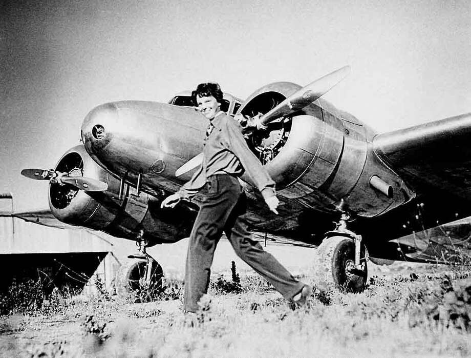 Amelia Earhart, who served as a consultant in the Department of the Study of Careers for Women at Purdue from 1935 to 1937, strides past her Lockheed Electra. Sally Putnam Chapman has donated 492 Earhart items -- including rarely seen personal and private papers such as poems, a flight log and a prenuptial agreement -- to Purdue Libraries' Earhart collection. (File photo)A publication-quality photograph is available at ftp://ftp.purdue.edu/pub/uns/earhart.newdocs/earhart.electra.jpeg.