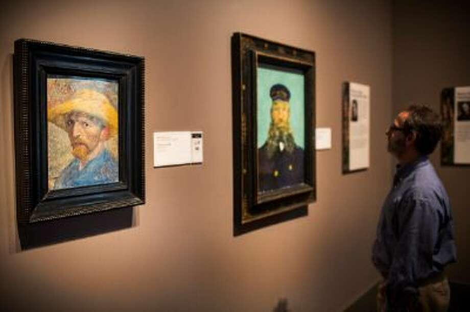 A man looks at a painting at the Detroit Institute of Arts. Photo: Getty Images / 2013 Getty Images