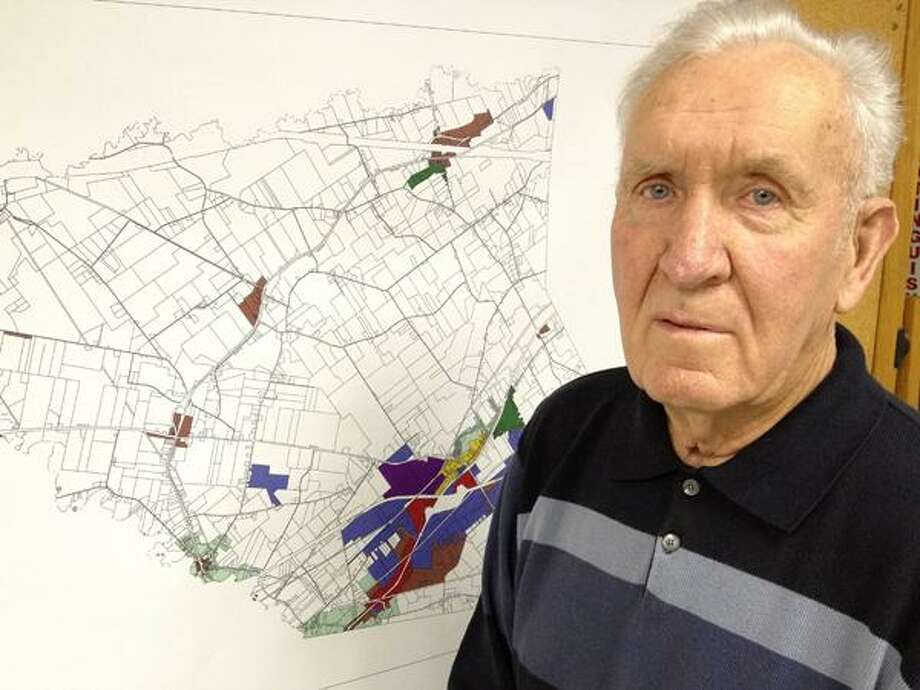 Dispatch Staff Photo by JOHN HAEGER (Twitter: @OneidaPhoto) Walter Hojnacki, 86, stands in front of a map of Verona. He has retired after 40 years of service on the town zoning board.